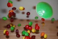 Skittles bouncing of a deck